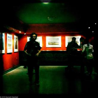 Man in underground art gallery